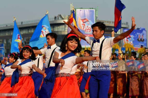 Dancers perform during a ceremony marking the 41st anniversary of the fall of the Khmer Rouge regime in Phnom Penh on January 7, 2020.