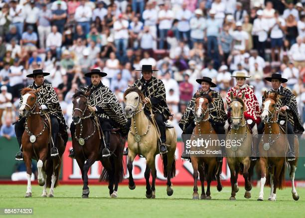 Dancers perform during a folklore show at the half of the chukker during the final match between La Dolfina and La Ellerstina as part of the HSBC...