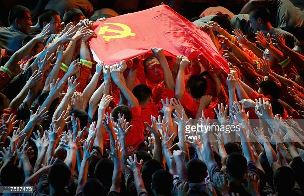 Dancers perform during a gala show to celebrate the 90th anniversary of the founding of the Communist Party of China in the Great Hall of the People...