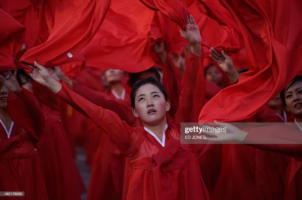 Dancers perform during a mass military parade at Kim Il-Sung square in Pyongyang on October 10, 2015. North Korea was marking the 70th anniversary of its ruling Workers' Party. AFP PHOTO / Ed Jones
