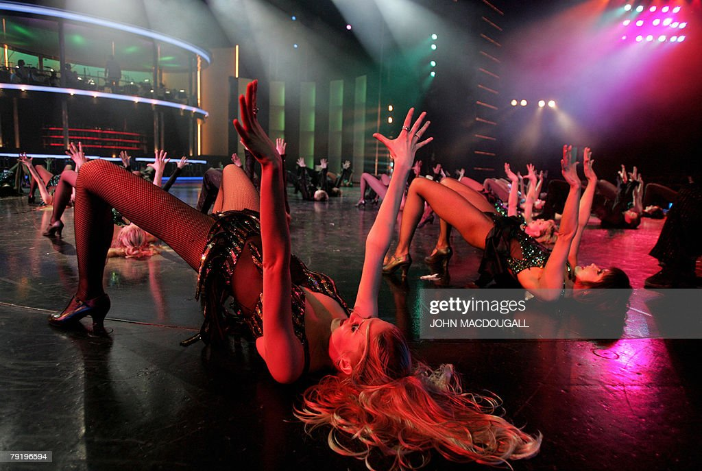 Dancers perform during a press preview of the Friedrichstadtpalast music hall's latest show 'Glanzlichter der Revue' (Limelights of the Revue) in Berlin 24 January 2008. The show leading from the 1920s cabaret passing over Broadway shows to Parisian revue opens 25 January 2008 and runs until 29 June 2008.