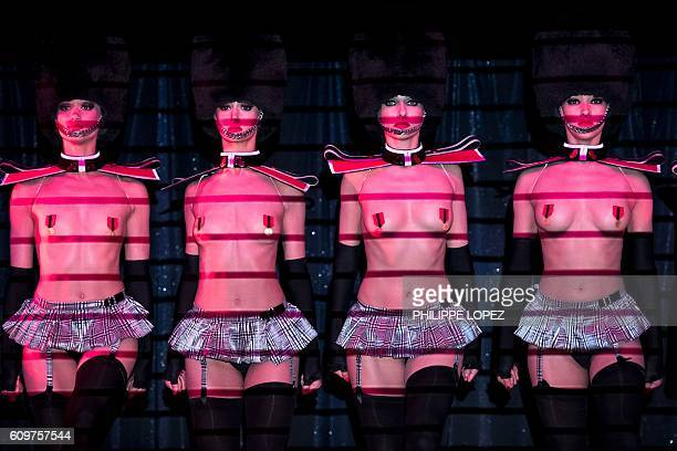 Dancers perform during a preview of the 'Dessus Dessous' show for which renowned Parisian lingerie designer Chantal Thomass was invited as a guest...
