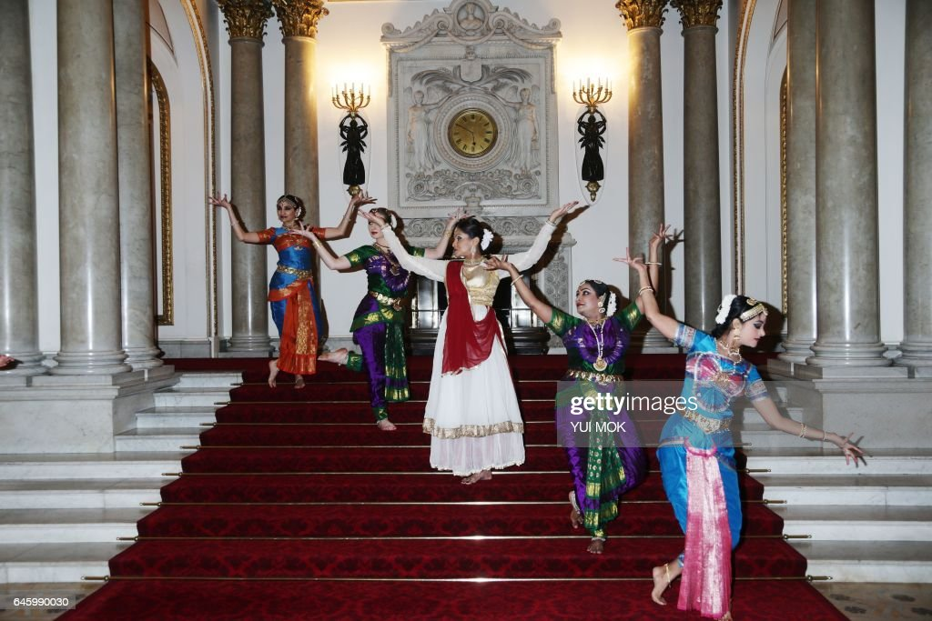 Dancers perform during a reception to mark the launch of the UK-India Year of Culture 2017 at Buckingham Palace in London on February 27, 2017. / AFP / POOL / Yui Mok