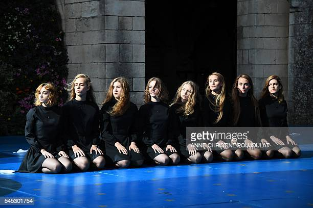 Dancers perform during a rehearsal of the play 'Que hare yo con esta espada' by Spanish director Angelica Liddell on July 6 2016 at the Cloitre des...