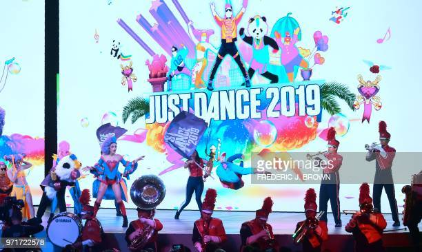 Dancers perform during an introduction to Just Dance 2019 at the Ubisoft E3 2018 media briefing inside the Orpheum Theatre in Los Angeles California...