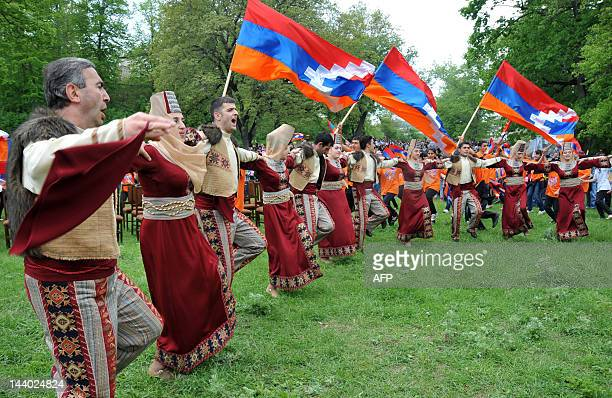 Dancers perform during celebrations devoted to 20th anniversary of the creation of the national army of Azerbaijan's breakaway region of Nagorny...