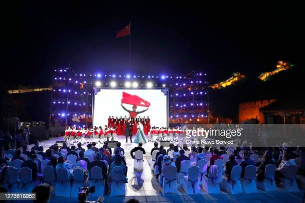 Dancers perform during cultural activities on the Badaling Great Wall to welcome the Beijing 2022 Olympic Winter Games' 500day countdown on September...