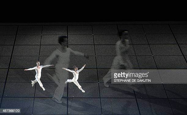 "Dancers perform during the ballet directed by US choreographer Lucinda Childs ""Dance"" on October 16, 2014 at the Theatre de la Ville in Paris. The..."