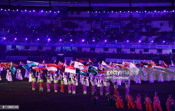 Dancers perform during the closing ceremonies of the 22nd Asian Athletics Championships on July 9 2017 at Kalinga Stadium in Bhubaneswar / AFP PHOTO...