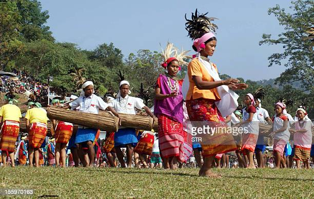Dancers perform during the conclusion of the Hundred Drums Wangala Festival at Asanang some 14 kms from Tura in the West Garo Hills district of the...