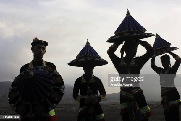 Dancers perform during the cultural ceremony 'Yadnya Kasada' to make an offering to their god at the plateau of Mount Bromo in Probolinggo, eastern...