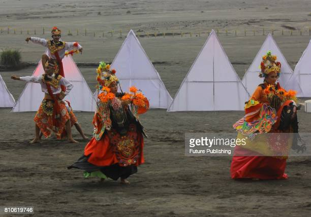 Dancers perform during the cultural ceremony 'Yadnya Kasada' to make an offering to their god at the plateau of Mount Bromo on July 7, 2017 in...