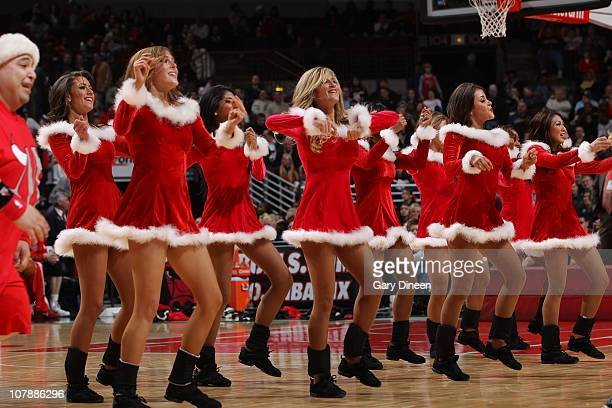 Dancers perform during the game between the Chicago Bulls and the Philadelphia 76ers on December 21 2010 at the United Center in Chicago Illinois The...
