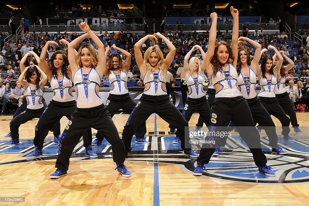 Dancers perform during the game between the Philadelphia 76ers and the Orlando Magic on March 10, 2013 at Amway Center in Orlando, Florida.