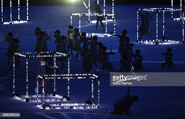 Dancers perform during the 'Love Sport Tokyo 2020' segment during the Closing Ceremony on Day 16 of the Rio 2016 Olympic Games at Maracana Stadium on...