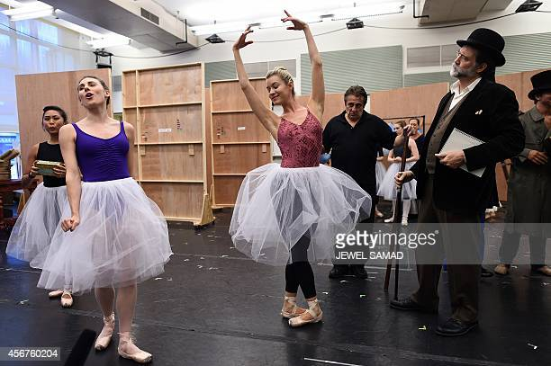 Dancers perform during the media preview of musical production Little Dancer in New York on October 6 ahead of its world premiere to be held at the...