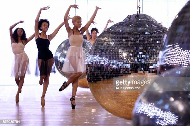 Dancers perform during the Moncler Gamme Rouge women's 2018 Spring/Summer readytowear collection fashion show in Paris on October 3 2017 / AFP PHOTO...