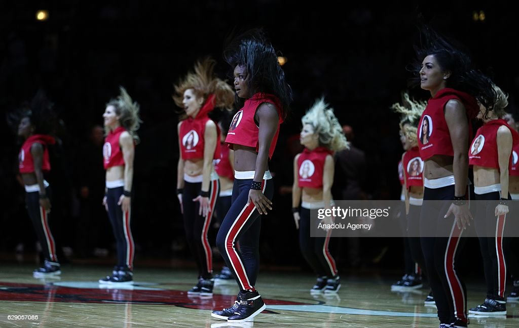 Dancers perform during the NBA match between Miami Heat and Chicago Bulls on December 10, 2016 at the United Center in Chicago, Illinois.