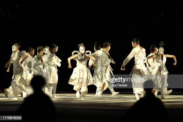 Dancers perform during the opening ceremony ahead of the Rugby World Cup 2019 Group A game between Japan and Russia at the Tokyo Stadium on September...