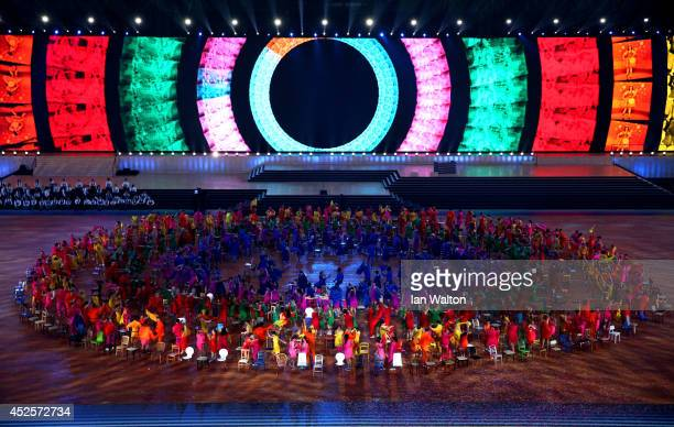 Dancers perform during the Opening Ceremony for the Glasgow 2014 Commonwealth Games at Celtic Park on July 23, 2014 in Glasgow, Scotland.