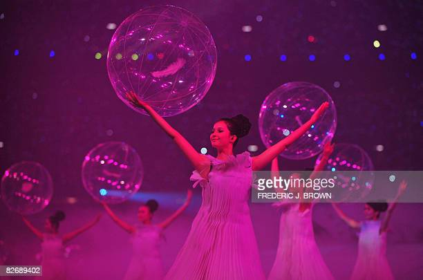 Dancers perform during the opening ceremony of 2008 Beijing Paralympic Games at the National Stadium also known as the Bird's Nest in the Chinese...