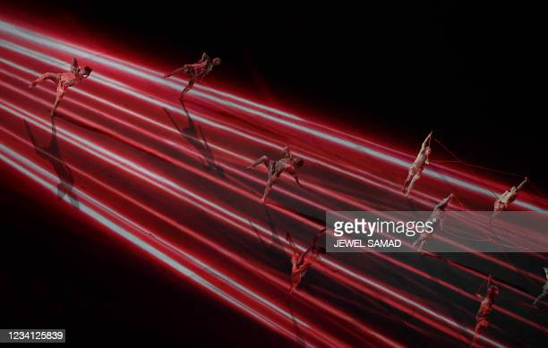 Dancers perform during the opening ceremony of the Tokyo 2020 Olympic Games, at the Olympic Stadium, in Tokyo, on July 23, 2021.