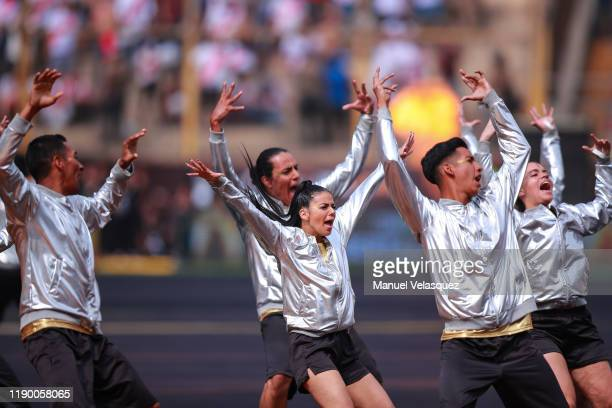Dancers perform during the pregame show prior to the final match of Copa CONMEBOL Libertadores 2019 between Flamengo and River Plate at Estadio...