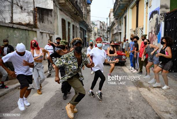 Dancers perform in a street of Havana, on May 21, 2021. - Driven by social networks, a troupe of young Cubans has attracted the attention of several...