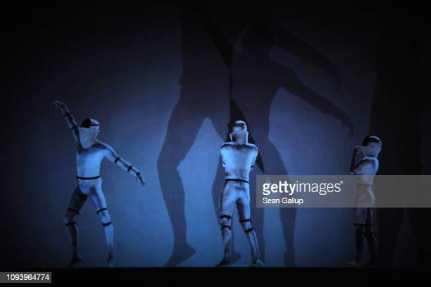 Dancers perform in a video of 'Das Totale Tanz Theater' at 'Bauhaus 100 Years The Opening Festival' during a press preview at the Akademie der Künste...