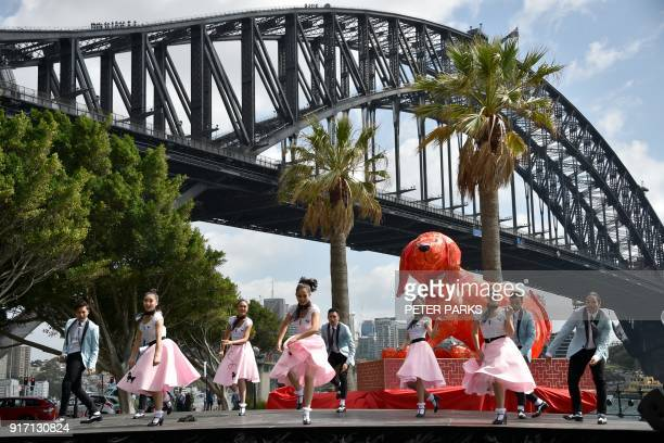 TOPSHOT Dancers perform in front of the harbour bridge at a media launch for the Lunar New Year Festival in Sydney on February 12 2018 The festival...