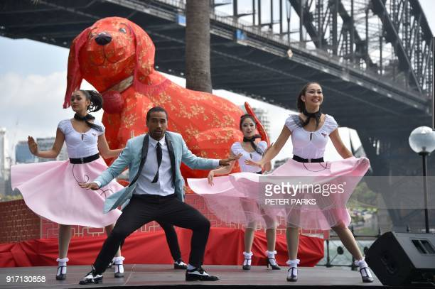 Dancers perform in front of the harbour bridge at a media launch for the Lunar New Year Festival in Sydney on February 12 2018 The festival to...