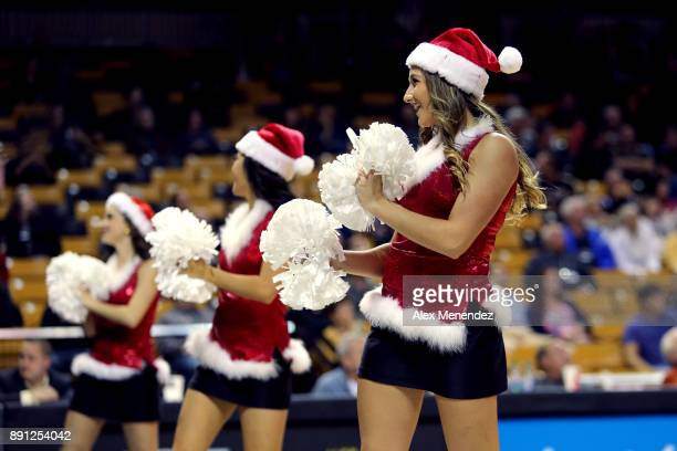 UCF dancers perform in Santa outfits during a NCAA basketball game between the Southeastern Louisiana Lions and the UCF Knights at the CFE Arena on...