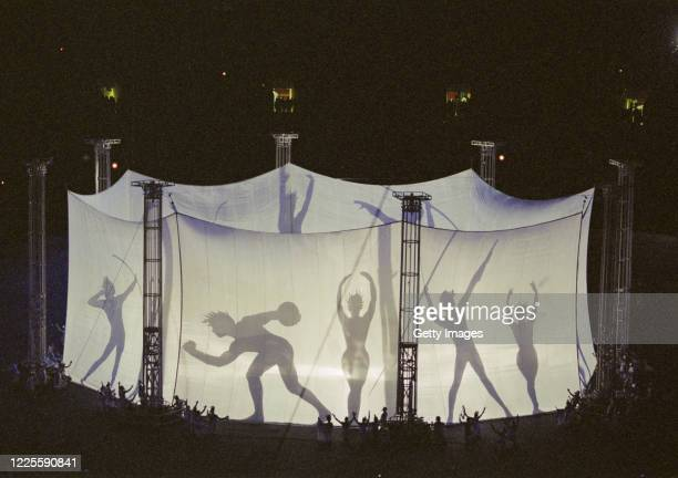 Dancers perform in silhouette form to reflect the classic poses of the ancient Greek athletes during the Opening Ceremony of the XXVI Summer Olympic...