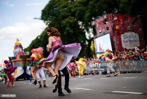 Dancers perform in the street during a Christmas parade on December 17 2017 in Buenos Aires Argentina
