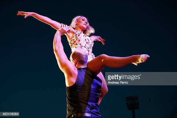 Dancers perform live on stage during the Andrea Berg Open Air festival 'Heimspiel' at mechatronik Arena on July 19 2014 in Grossaspach Germany