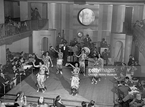 Dancers perform on stage at a blackandtan club while accompanied by a band in the background Chicago ca1920s The clubs almost always featured African...
