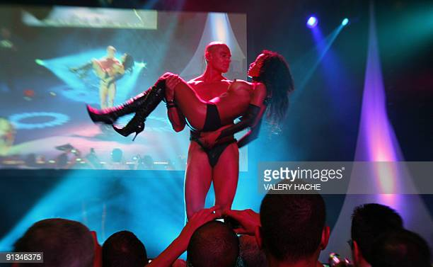 Dancers perform on stage during the Erotica Dream fair on October 2 2009 in Nice southeastern France The exhibition is held from October 2 to 4 2009...