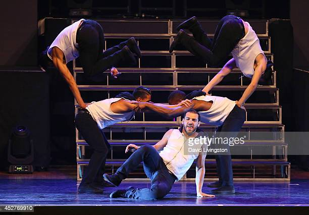 Dancers perform on stage during the Move Live on Tour production at the Orpheum Theatre on July 26 2014 in Los Angeles California