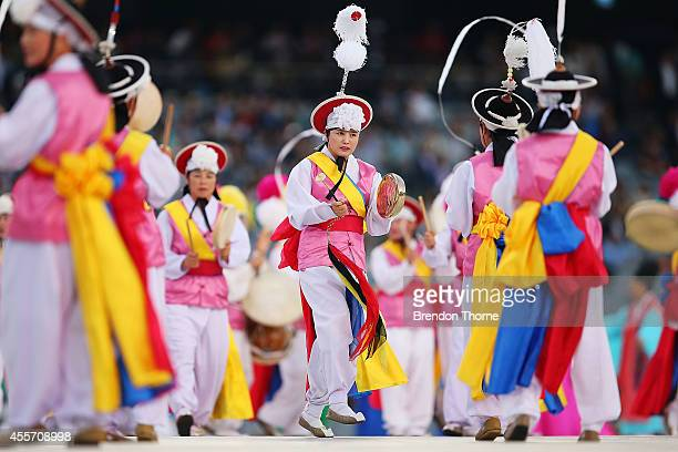 Dancers perform on stage during the Opening Ceremony ahead of the 2014 Asian Games at Incheon Asiad Main Stadium on September 19 2014 in Incheon...