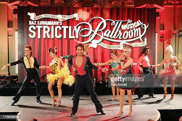 Dancers perform on stage during the photo call for 'Strictly Ballroom The Musical' at Town Hall on August 5 2013 in Sydney Australia