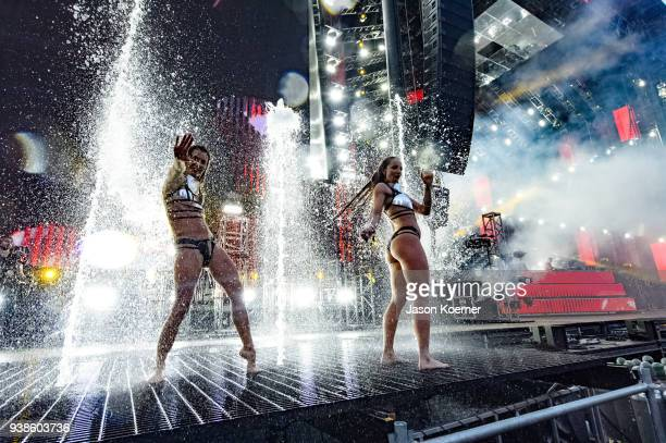 Dancers perform on stage during Ultra Music Festival 2018 at Bayfront Park on March 24 2018 in Miami Florida