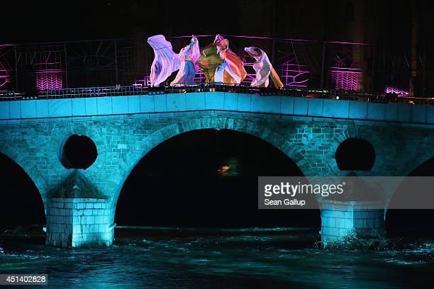 Dancers perform on the Latin Bridge during a theatrical piece commemorating World War I near the spot where Serbian secessionist Gavrilo Princip shot...