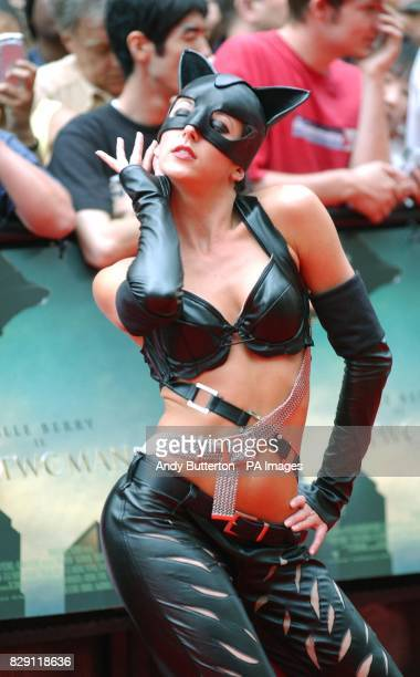 Dancers perform on the red carpet during the European premiere of Catwoman at the Vue cinema in Leicester Square central London