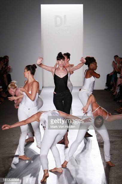 Dancers perform on the runway at the Fashion Palette NY Debut spring 2013 fashion show during Mercedes-Benz Fashion Week at Canoe Studios on...