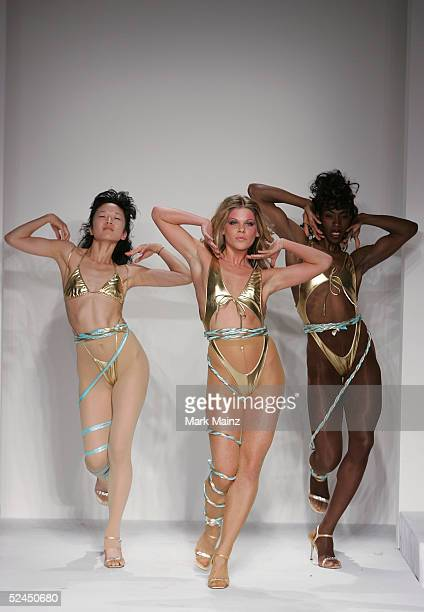 Dancers perform on the runway at the Grey Ant Fall 2005 show during MercedesBenz Fashion Week at Smashbox Studios March 18 2005 in Culver City...
