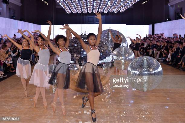 Dancers perform on the runway at the Moncler Gamme Rouge Spring Summer 2018 fashion show during Paris Fashion Week on October 3 2017 in Paris France