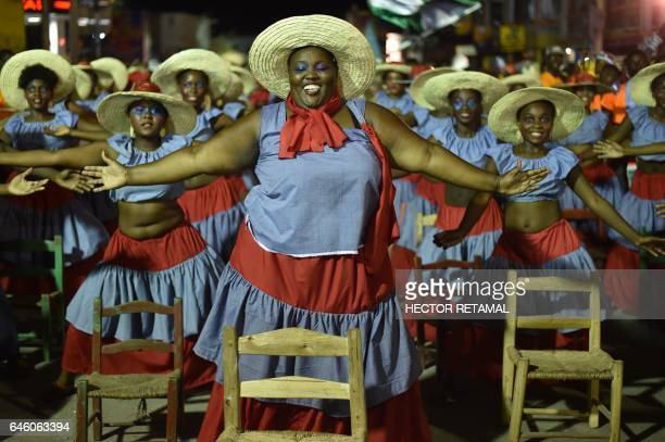 TOPSHOT Dancers perform on the second day of the 2017 National Carnival Parade on February 27 2017 in the city of Les Cayes southwest Haiti The name...
