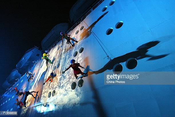Dancers perform on the shipboard of the Italian cruise liner Costa Allegra during a ceremony to celebrate the ship's first journey up the Huangpu...