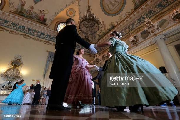 Dancers perform on valzer and dances of the nineteenth century during the historic ball that was held in the hall of dances at the Royal palace of...