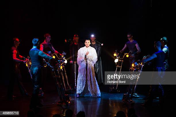 Dancers perform onstage during the last show of the 'Bonheur' Revue at the Lido on December 2 2014 in Paris France